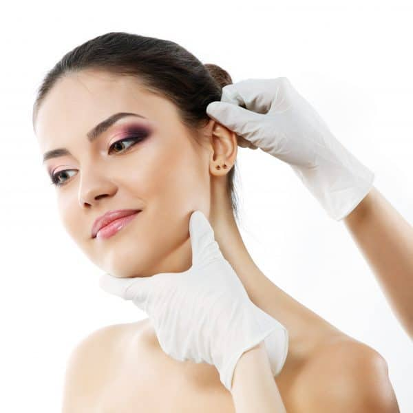 woman having her ears pinned back in Manchester cosmetic surgery hospital.