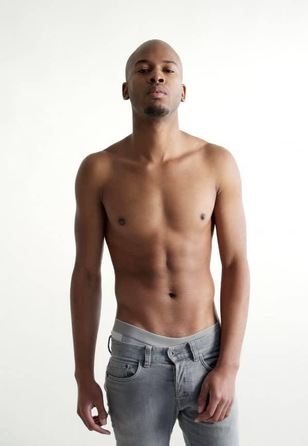 topless man looking straight at camera.