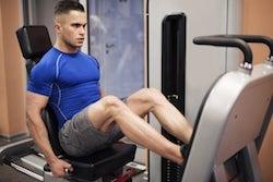 man exercising on leg press machine PBHRYLQ 600x400 1